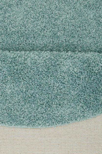 Okrągły, kudłaty dywan w kolorze morskim