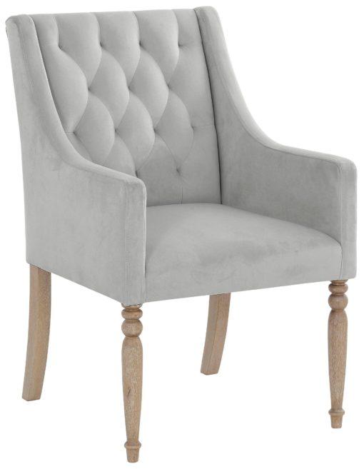 Fotel z toczonymi nogami i pikowanym oparciem