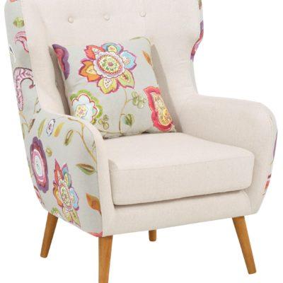 Fotel jak uszak z kwiatowym wzorem i poduszką