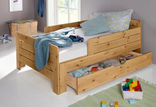 Sosnowa szuflada pod łóżko dziecięce
