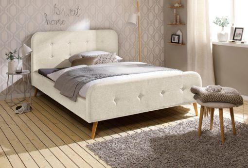 Piękne, tapicerowane łóżko w klasycznym stylu