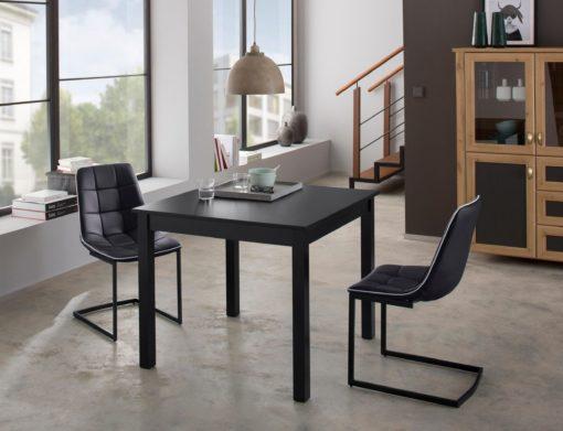 Czarny stół do jadalni z płytką przedłużającą
