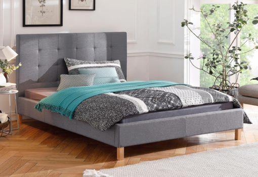 Eleganckie łóżko z wysokim, pikowanym zagłówkiem 140x200 cm