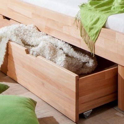 Dwie szuflady pod łóżko z bukowymi frontami