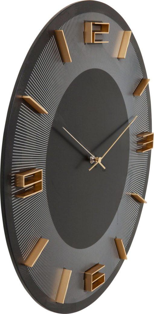 Nowoczesny, czarny zegar z kontrastującymi złotymi cyframi