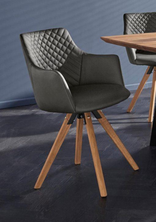 Dwa fotele tapicerowane prawdziwą skórą, na dębowych nogach