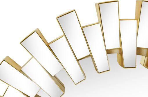 Okrągłe lustro w ciekawej złotej ramie