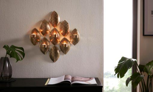 Ażurowy, złoty świecznik na ścianę