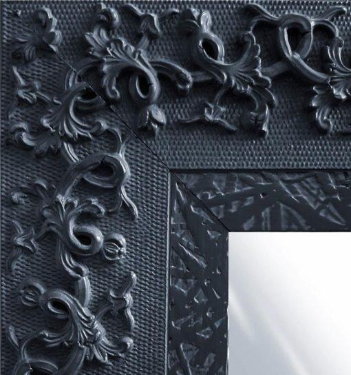 Lustro ścienne z czarną, zdobioną ramą