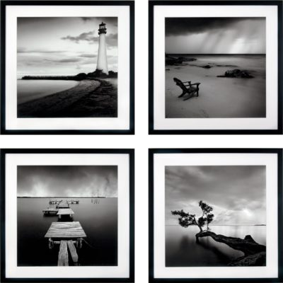 Zestaw czterech obrazów w czarnej ramie, druk artystyczny