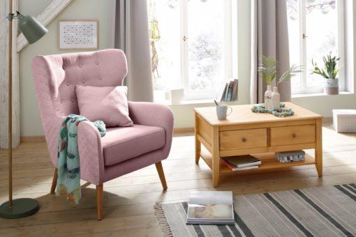 Fotel jak uszak z poduszką i przeszyciami na plecach i bokach