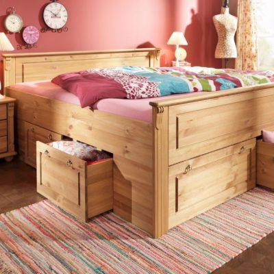 Dwie sosnowe szuflady pod łóżko na kółkach