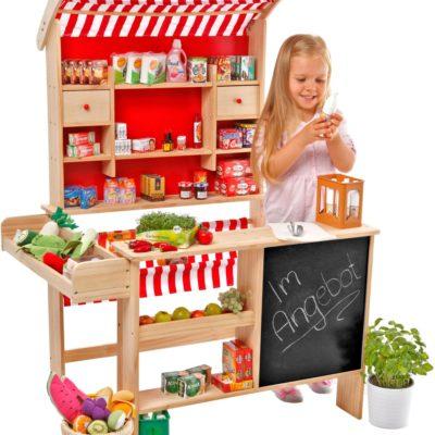 Drewniany sklep z miniaturami i tablicą TANNER