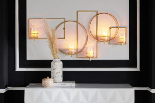 Duży świecznik na ścianę wykonany z metalu, złoty