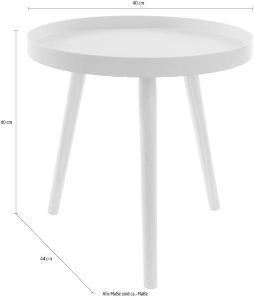 Mały stolik z różowym blatem w skandynawskim stylu